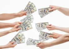 Mani umane che tengono molti dollari Immagini Stock