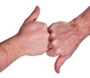Mani umane con su e giù le dita su bianco Fotografia Stock