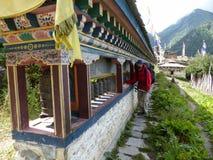 Mani wall in Upper Pisang, Nepal. Upper Pisang village, Annapurna Circuit trek in Nepal royalty free stock images
