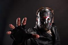 Maniac in hockey mask on dark background Royalty Free Stock Photography