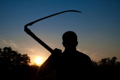 Maniac with a scythe Stock Image