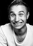 Maniac sfrenatamente sorridente fotografia stock libera da diritti