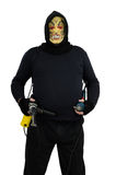 Maniac standing with perforator and electric drill. Black masked maniac standing with perforator and electric drill Stock Photos