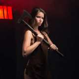 Maniac woman with ax. Woman maniac with ax in hand on grid background Stock Images