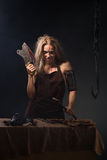 Maniac woman with a knife in his hand. On a gray background Stock Photography