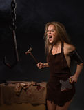 Maniac woman with a knife in his hand. Beautiful woman with a knife in his hand on a gray background Stock Photography