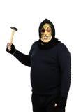 Maniaco enmascarado que blande un martillo Foto de archivo libre de regalías