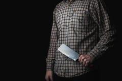 Maniaczka z dużym nożem na ciemnym tle, fotografia stock