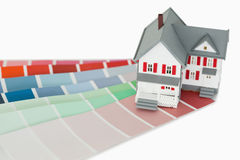 A maniature house and a color chart. Against a white background royalty free stock photos