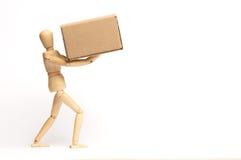 Manichino con il pacchetto Fotografia Stock Libera da Diritti