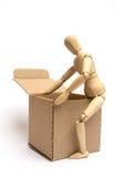 Manichino con il pacchetto Fotografia Stock