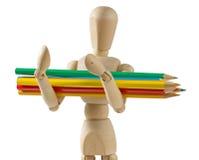 Manichino di legno che porta le matite colorate immagini stock libere da diritti