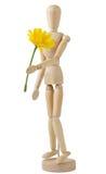 Manichino di legno che porta un fiore fotografia stock