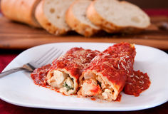 Manicotti and bread Stock Photo