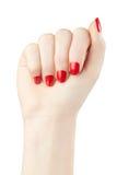 Manicura en la mano femenina con el esmalte de uñas rojo fotos de archivo libres de regalías
