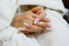 Manicure. Beautiful manicure in a delicate fingers girl, elegant manicure Royalty Free Stock Photo