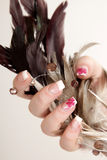 Manicure. Girls hand with manicure holding feathers Royalty Free Stock Photo