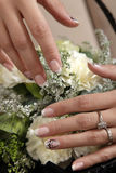 Manicure. Hands with manicure holding flowers Stock Images