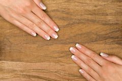 Manicure. Nice hands on wood with textfield Stock Images