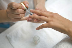 Manicure. Female getting her nails painted during a manicure Royalty Free Stock Photo