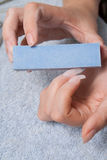 Manicure. And design of nails process of polishing by a nail file stock photo