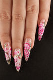 Manicure. Girl fingers with beautiful drawing on nails royalty free stock images