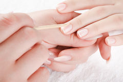 Manicure. Beautiful hands are doing manicure Royalty Free Stock Photos