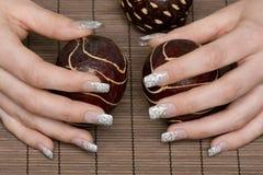 Manicure. Nice hands on a phloem mat Royalty Free Stock Photo