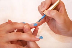 Manicure. Hands during the manicure work Stock Photography