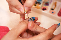 Manicure. Hands during the manicure work Royalty Free Stock Images