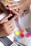 Manicure. Nail painting in beauty studio Stock Photo