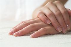 Manicure. Nice hands on white towel. Soft manicure stock photo