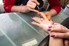 Manicure. Manicurist treating customer at beauty salon Royalty Free Stock Photography