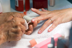 Manicure. Treatment at beauty salon royalty free stock photos