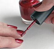 Manicure. The process of painting a woman's fingernails or getting a manicure Stock Photo