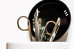 Manicure accessories in sterilizer isolated Royalty Free Stock Photography