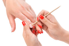 Manicure applying - cleaning the cuticles Royalty Free Stock Image