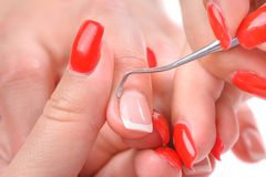 Manicure applying - cleaning the cuticles Stock Image