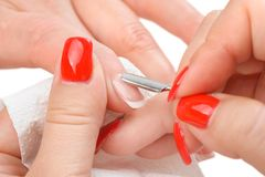 Manicure applying - cleaning the cuticles Royalty Free Stock Photos
