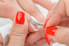 Manicure applying - cleaning the cuticles Stock Photography