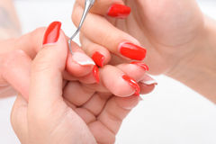 Manicure applying - cleaning the cuticles Stock Photos