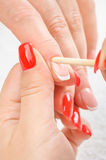 Manicure applying - cleaning the cuticles Royalty Free Stock Photography