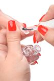Manicure, applying clear enamel Stock Image