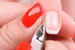 Manicure applying - cutting the cuticle Royalty Free Stock Photos