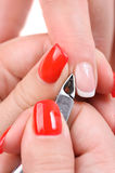 Manicure applying - cutting the cuticle Stock Photos