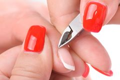 Manicure applying - cutting the cuticle Stock Images