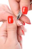 Manicure applying - cutting the cuticle Royalty Free Stock Photography