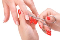 Manicure applying - cutting the cuticle Stock Image