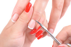 Manicure applying - cutting the cuticle Royalty Free Stock Image