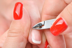 Manicure applying - cutting the cuticle Royalty Free Stock Images